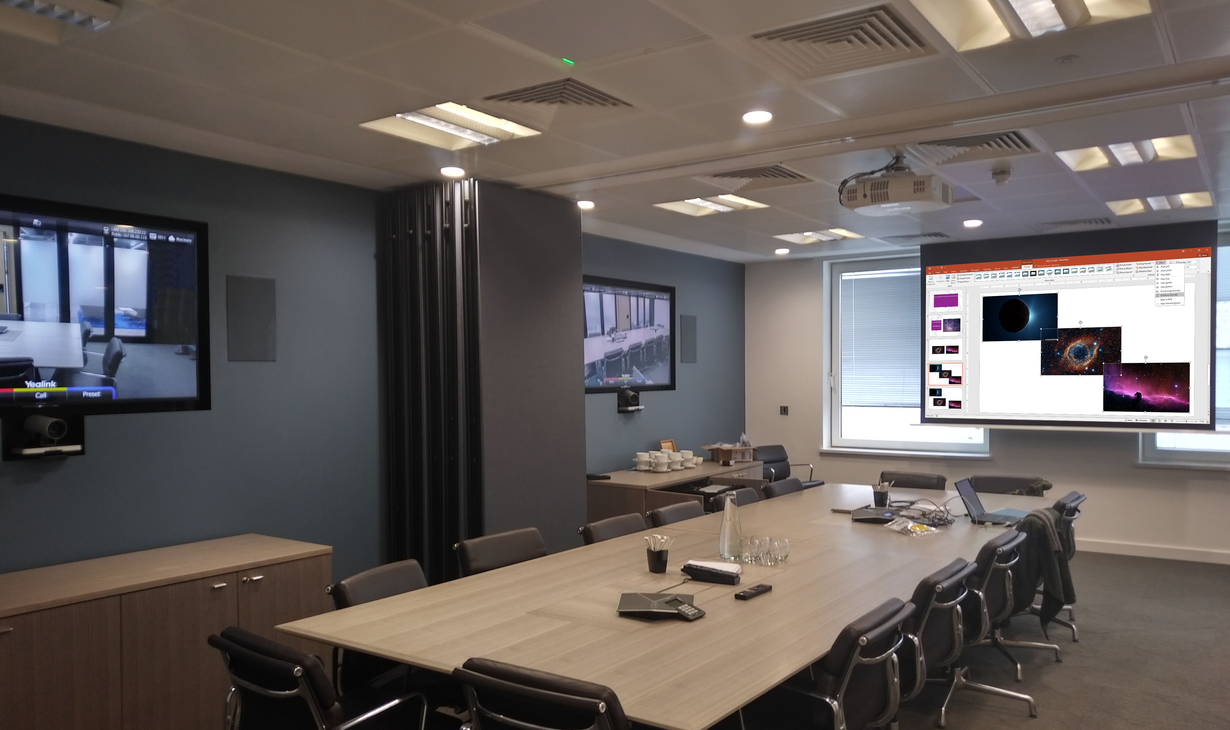 Advanced boardroom AV with ceiling microphone, VC system, projection, dual monitors, automated controls